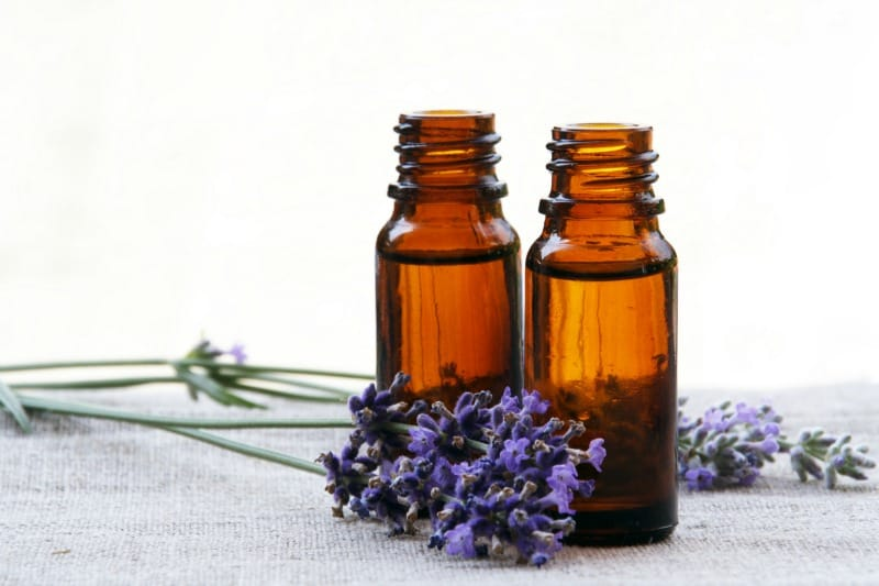Essential oil bottles and lavender flowers