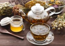 A cup of herbal tea and honey