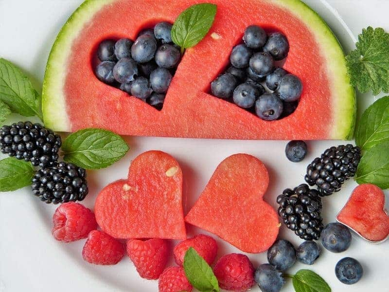 Fresh fruit on a plate: watermelon, blueberries and raspberries
