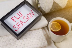 Cup of tea and a frame wiht flu season wording on it