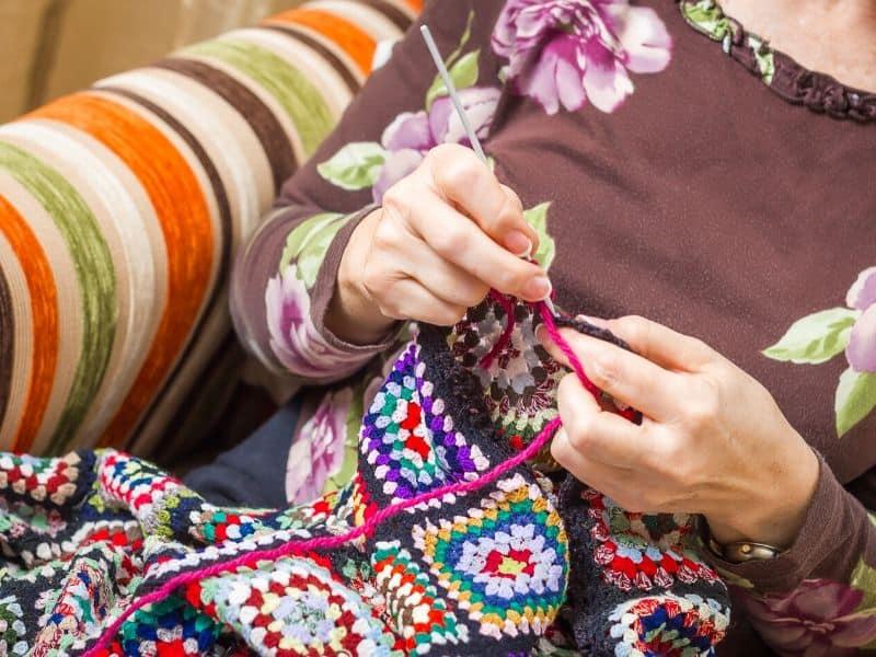 Woman crocheting blannket