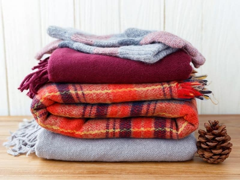 A stack of blanket scarfs