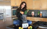 Devin in the kitchen with her blender and fresh produce