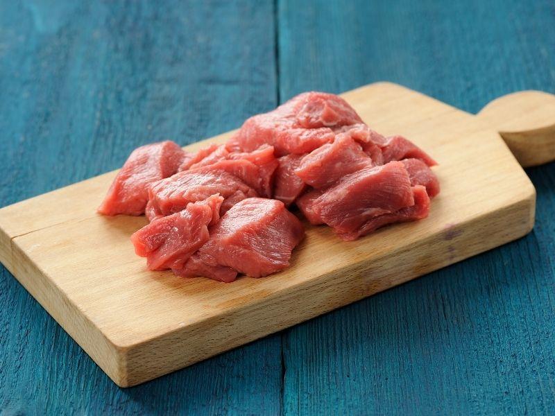 Meat chunks on a woodeen cutting board