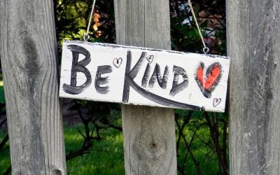 fence sign saying be kind