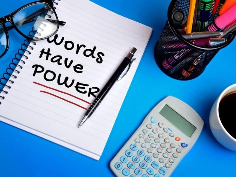 notebook with a note that says words have power