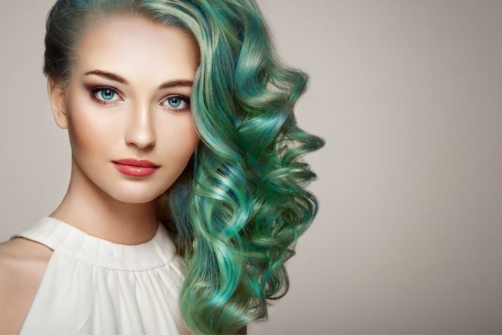 young woman with green hair